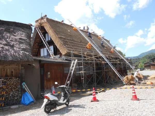Rethatching work at Shirakawago Gassho farmhouse on May , 2015.