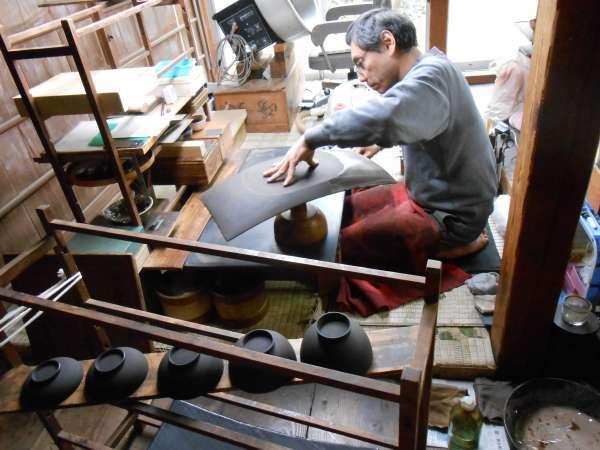 an artisan at Wajima lacquerware workshop of Yamazaki.