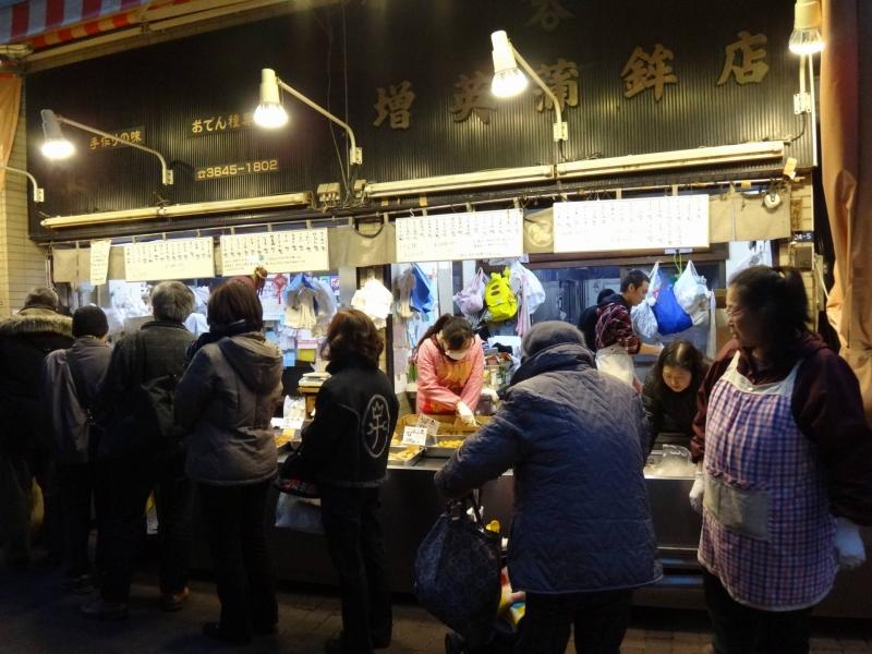 When evening falls, locals gather to buy food for dinner in Sunamachi Shotengai shopping avenue.