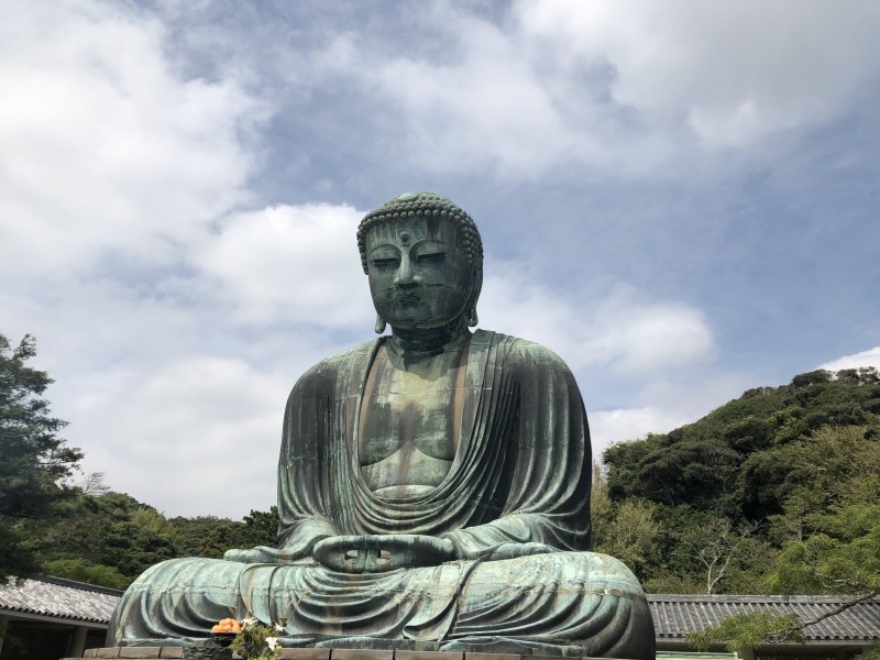 Kotoku-in Temple The Great Buddha of Kamakura is a bronze statue of Amida Buddha, which stands on the grounds of Kotoku-in Temple. With a height of 11.5m , 121tons, the Buddha has been standing in the open air since the temple buildings were destroyed by typhoons and a tsunami in 14th and 15th centuries.
