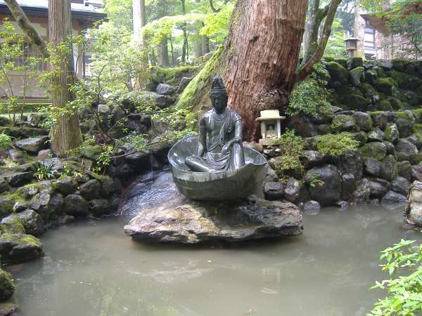 A monk on a boat, which suggests Dogen zenji crossed the sea to China.