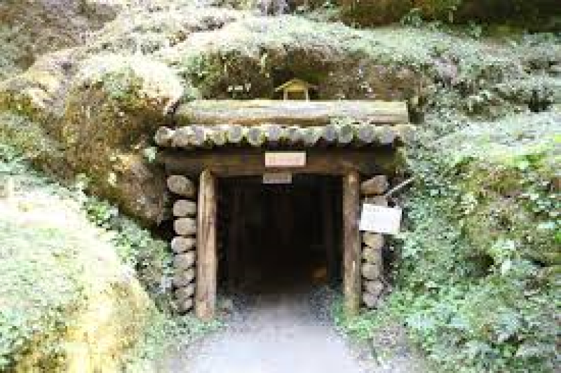 The entrance of a mine shaft. You can go inside and walk.