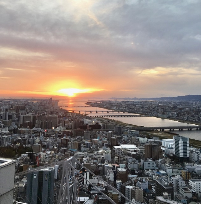 Sunset and view to the Yodo river from the Umeda Sky Building. Just one of 360 degrees to see around and get to know the city, sea, and mountains from above.