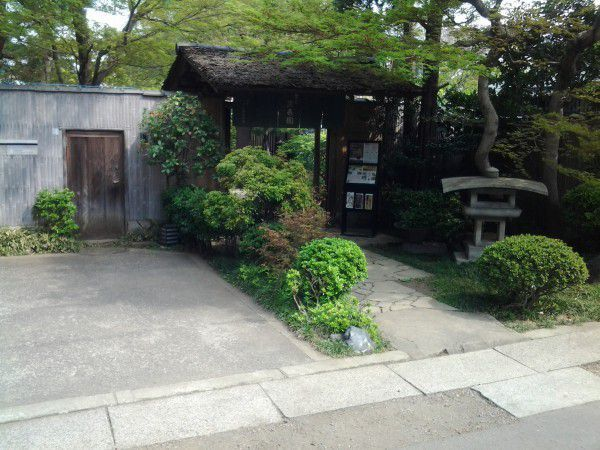 In front of one of the bonsai gallery