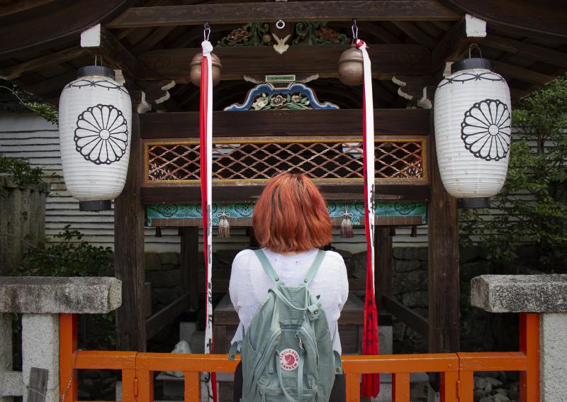 Praying at a small shrine