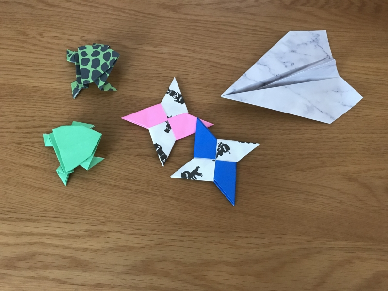 An airplane, jumping frogs and ninja throwing knives.