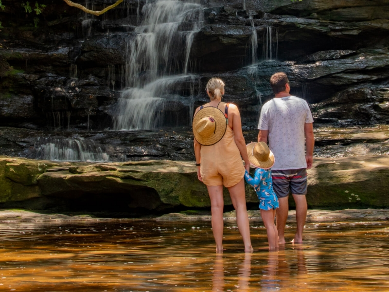 Finish off the day with a quick dip under a waterfall, or sit beside it sipping complimentary wine and chocolate