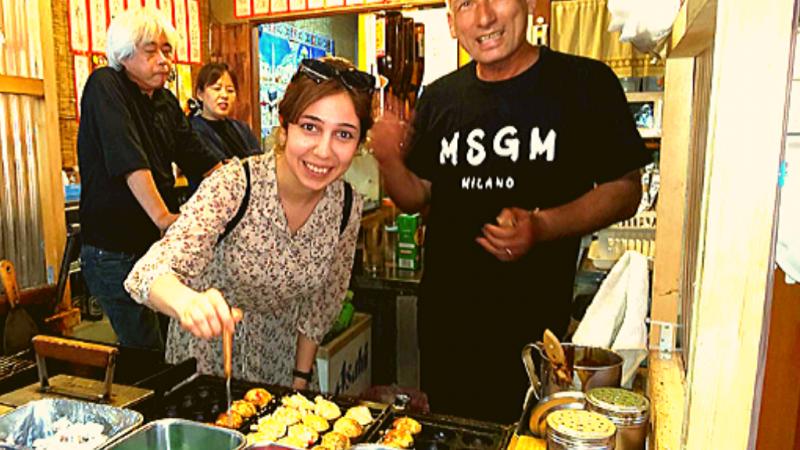 Do some taste testing at a delicous takyaki stall.