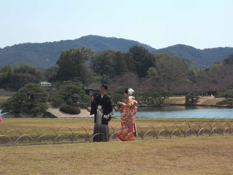 the newlywed couple wearing traditional bridal dress
