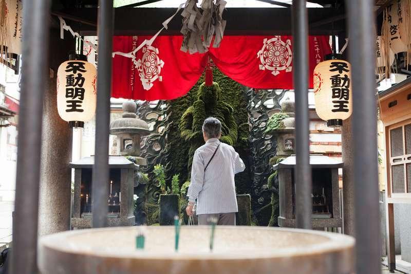 Hozenji Temple famous for moss-covered Mizukake Fudoh ( water-splashed Fudoh Myo-oh, a stone Buddhist statue )