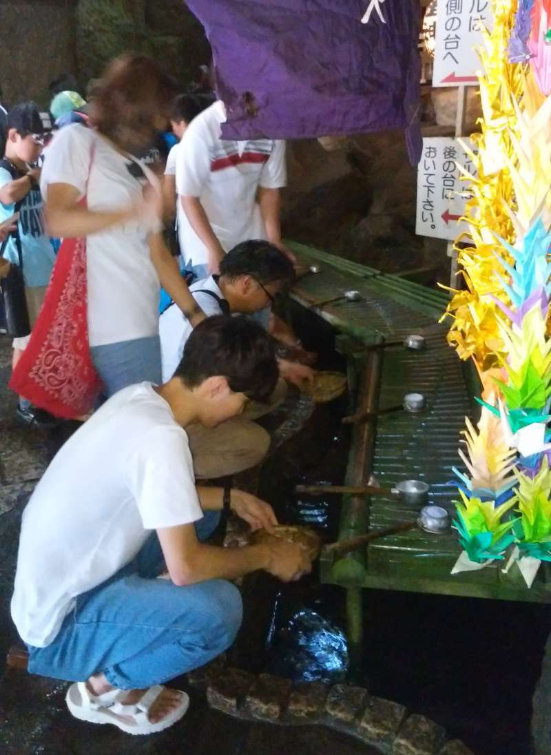 At Zeniaraibenzaiten Shrine, people wash their money with the sacred spring  water to wish for making more money!